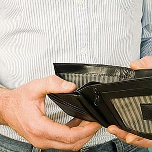 image: Man holding empty wallet © CharlesSturge.com, Image Source, Getty Images