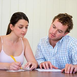 Image: Couple with paperwork © IT Stock Free, Jupiterimages
