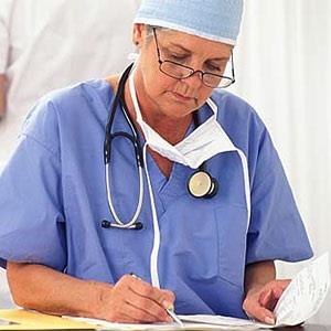 Image: Surgeon with paperwork (© Creatas Images/JupiterImages Corporation)