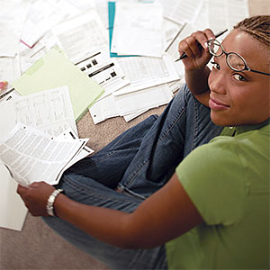 Logo: Woman with paperwork (Comstock Select/Corbis)