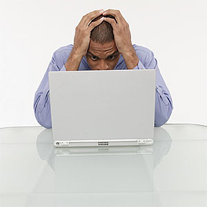 Logo: Man with laptop (Comstock Images/Jupiterimages)