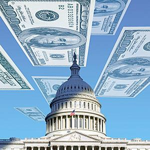 Dollar bills floating over U.S. Capitol © Corbis