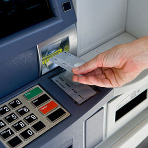 Cash machine © Compassionate Eye Foundation/Getty Images