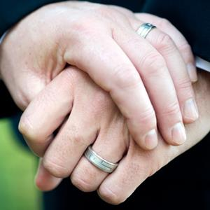 Gay couple with wedding rings (© Chris Howey/iStock/360/Getty Images)