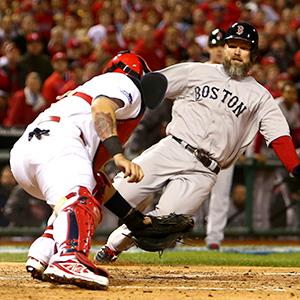 Yadier Molina #4 of the St. Louis Cardinals gets the out on David Ross #3 of the Boston Red Sox in the seventh inning during Game Five on October 28, 2013 (© Ronald Martinez/Getty Images)