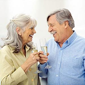 Senior couple holding champagne flutes, smiling at each other© PhotoAlto/Eric Audras/PhotoAlto Agency RF/Getty Images