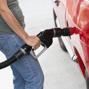 Filling fuel tank © Corbis