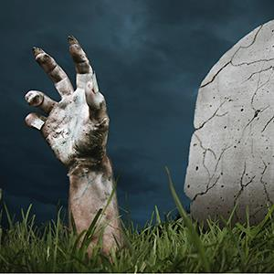 A zombie hand coming out of the ground (©Fernando Gregory Milan/Getty Images)