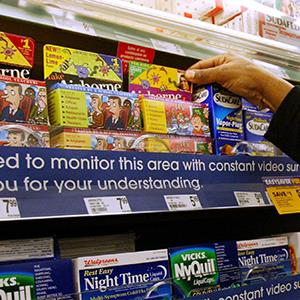 Customer shopping for medications in a Walgreens drugstore (© Nam Y. Huh/AP Photo)