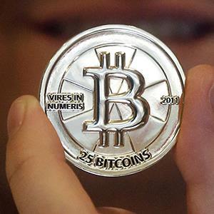 A 25 Bitcoin token (©Rick Bowmer/AP)