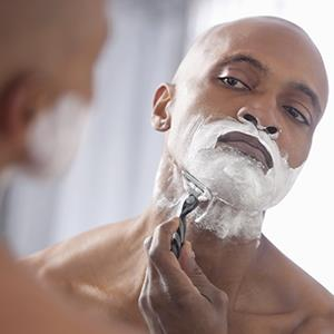 Man shaving (© John Fedele/Blend Images/Getty Images)