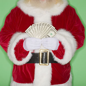 Santa Claus with cash © Tetra Images/Jupiterimages