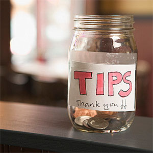 Still life of a nearly empty tip jar © Big Cheese Photo, SuperStock