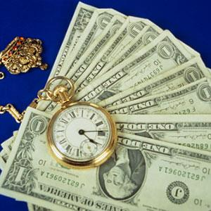 Money and a gold pocket watch © Russell Illig/Photodisc/Getty Images