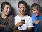 Image: Teens with MP3 player (&#194;&#169; RubberBall/SuperStock)
