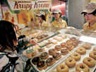 Credit: &#169; Vincent Thian/AP&#xA;Caption: A customer orders doughnuts at a Krispy Kreme store in Tokyo, Japan