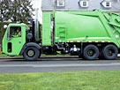Image: Garbage men operating garbage truck (© Don Mason/Blend Images/Corbis)