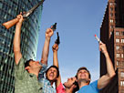 Image: Men playing with guns (© Leander Baerenz/Digital Vision/Getty Images)