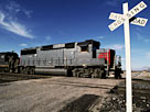 Image: Railroad Crossing with Train (© Edmond Van Hoorick/Photodisc/Getty Images)