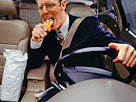 Image: Businessman devouring fries whilst driving car (&#194;&#169; Ryan McVay/Photodisc/Getty Images)