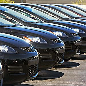 Row of cars in car lot, copyright fotog, Tetra images, Getty Images