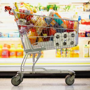 Full Shopping Cart in Grocery Store -- Fuse/Getty Images