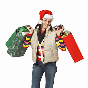 Image, Woman with Santa hat, copyright Stockdisc, SuperStock
