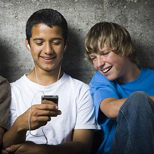 Image, Teens with MP3 player copyright RubberBall, SuperStock