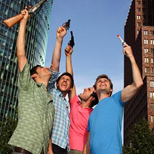 Men with toy guns --Leander Baerenz/Digital Vision/Getty Images