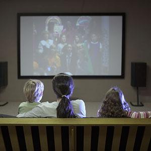 Watching television, copyright Frare, Davis Photography, Brand X, Corbis