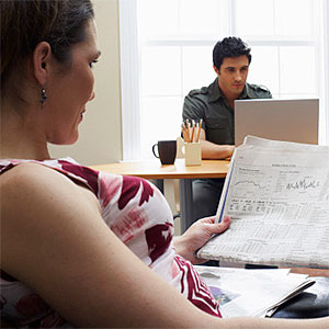 Couple in Home Office -- Radius Images, Radius Images, Getty Images