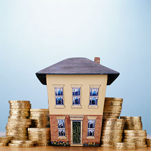 Image: House with coins (Digital Vision/Getty Images)