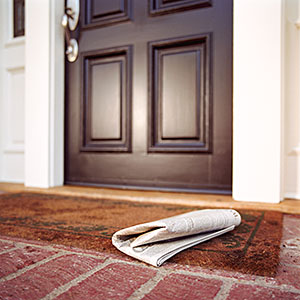 Newspaper on front step of house copyright Siri Stafford, Photodisc, Getty Images