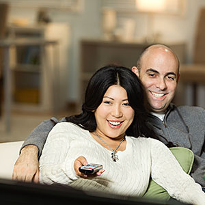 Couple on sofa watching television together copyright Blend Images, Hill Street Studios, the Agency Collection, Getty Images