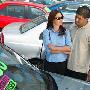 Couple shopping for car copyright Medio Images, Getty Images
