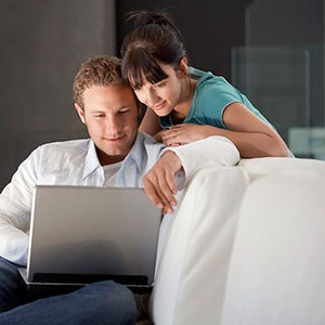 Couple with laptop copyright Corbis