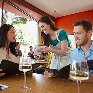 Image, Couple ordering meal in restaurant copyright NULL, Corbis