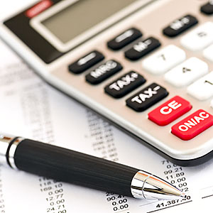 Calculating numbers for income tax return with pen and calculator copyright Stockbrokerxtra Images, Photolibrary