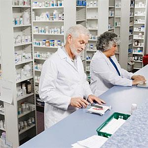 Pharmacists filling prescriptions copyright UpperCut Images, UpperCut Images, Getty Images