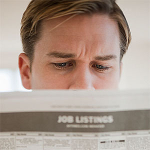 Man reading job listings copyright Tetra Images, Tetra images, Getty Images