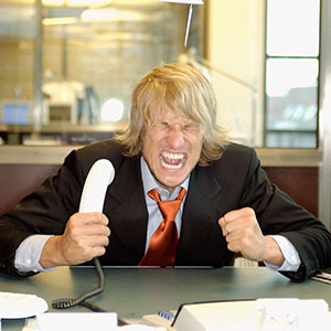 Angry businessman copyright Imagesource, Corbis