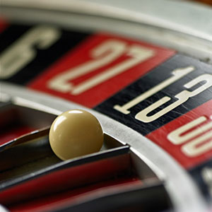 Ball on Roulette wheel, close-up copyright Adam Gault, Digital Vision, Getty Images