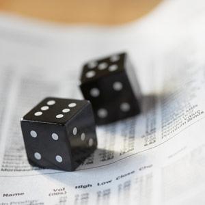 Dice on stock listings -- Kate Kunz/Corbis