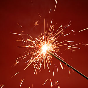 Close-up of a burning sparkler copyright IMAGEMORE Co., Ltd., Imagemore, Getty Images