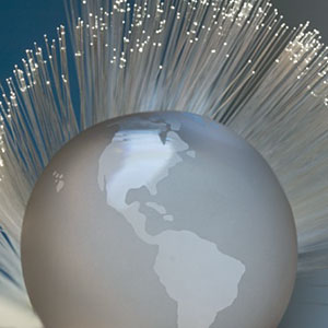Silver globe with twinkling lights copyright Tetra Images, Getty Images
