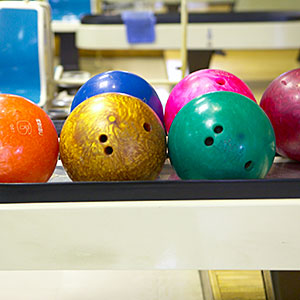 Bowling balls in bowling alley copyright Doable, amanaimagesRF, amana images, Getty Images