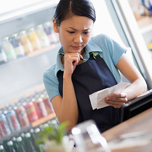  Grocery clerk copyright Corbis, SuperStock