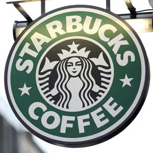 A Starbucks Corp sign is displayed outside a coffee shop in London UK Chris Ratcliffe Bloomberg via Getty Images