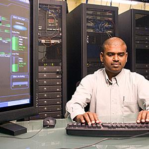  Technician working on a network server copyright Purestock, Purestock, Getty Images