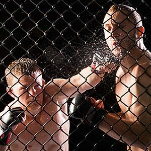 Cage fighters copyright Mike Kemp, Tetra images, Getty Images